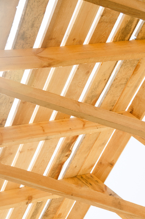 rafters: Wooden roof construction. House construction process. Building in progress. Stock Photo