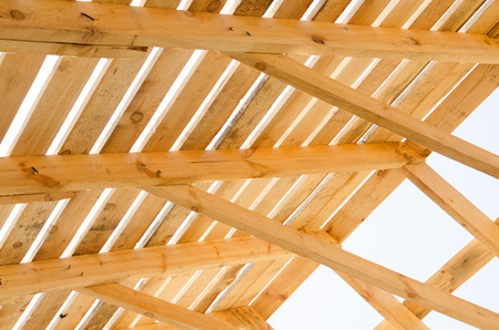 Wooden roof construction. House construction process. Building in progress. Stock Photo