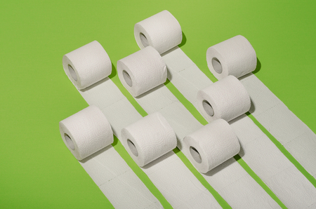 Hygiene and health. Concept photo. Toilet paper concept on green background.