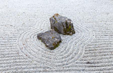 raked: Japanese style garden with rocks and raked gravel Stock Photo