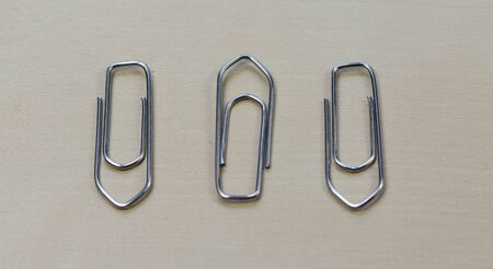 paper clips: three paper clips Stock Photo