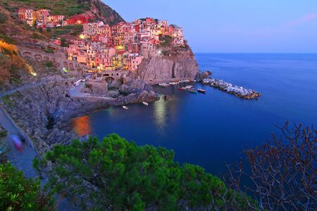 cinque: Wide view of Manarola at the blue hour Stock Photo