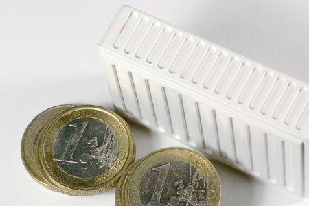 White radiator with euro coins photo