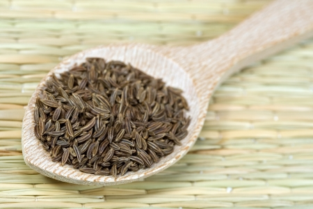 caraway seeds on a wooden spoon