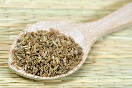 aniseed: aniseed on a wooden spoon