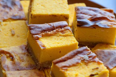 homemade yellow orange cheesecake in pieces