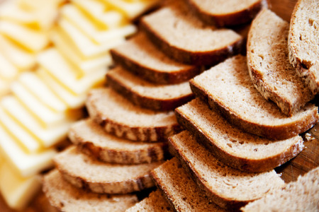 Bread and cheese in slices Standard-Bild