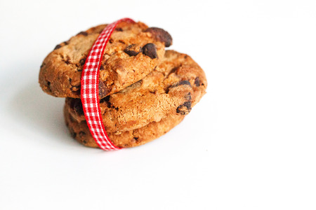 Cookies on white with ribbon in red white