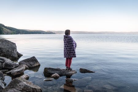 Meditation on the lakes coast at sunrise