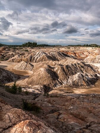 Clouds above clay quarry in the evening