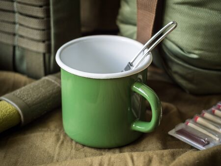 Modern outdoor survival kit in green tones