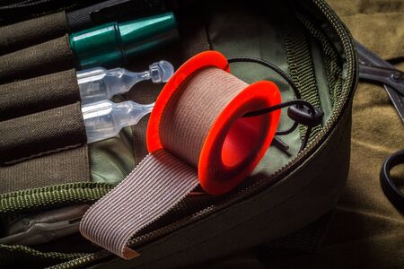 Closeup view of textile medical tape roll in pocket military first aid kit. First aid in an emergency Stock fotó