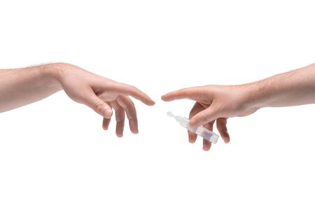 Two male hands passing one another small plastic phial with clear liquid on white background