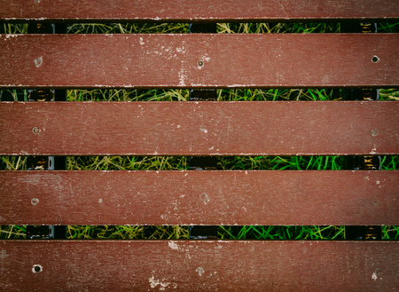 Old Red Brown Wooden Bridge Texture Background over the grass swamp on Sunny Day Stock Photo