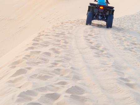 The Man on A Quad Biking in The White Sand Dunes in Mui Ne, Vietnam