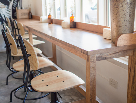 Modern Wooden Chais And Wooden Bar Table In White Butique Cafe With Soft  Sun Light From