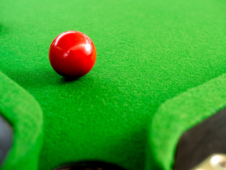 Red Snooker Ball Near Corner Hole on Green Snooker Table 스톡 콘텐츠