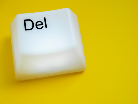 Big Delete Computer Key Button Light Box Isolated on Yellow Background with Space. Eraser Concept.