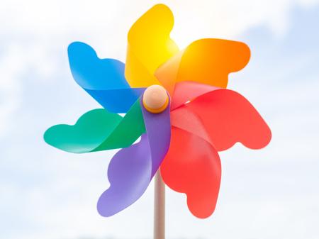 Beautiful colorful pinwheel on blue sky background on sunny day. Foto de archivo