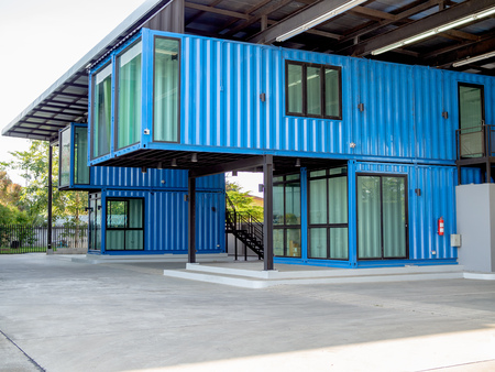 Modern blue cutting-edge shipping container construction office building. Foto de archivo
