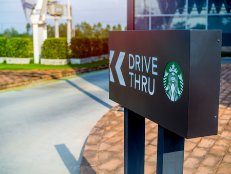 AYUTTHAYA, THAILAND - December 7, 2018: Drive thru sign of Starbuck Coffee shop in Flynow outlet shopping mall on Highway at AYUTTHAYA, THAILAND. Editorial