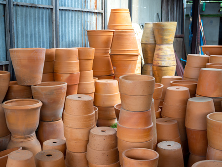 Many piles of terracotta pots in local terracotta pot factory.