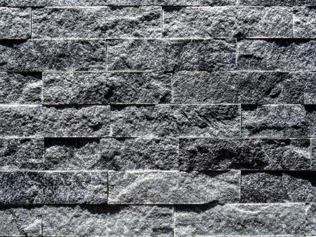 Close-up modern grey brick wall background. Grey stone brick tiles texture. 版權商用圖片