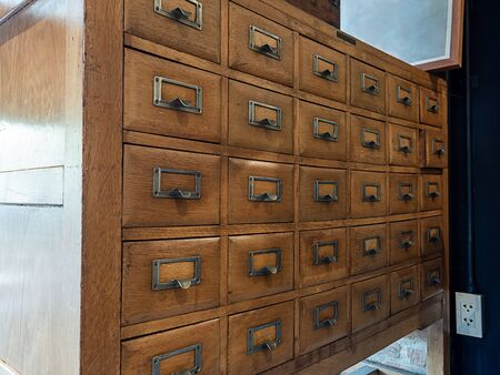 Old vintage wooden library card catalog cabinets in Library room.