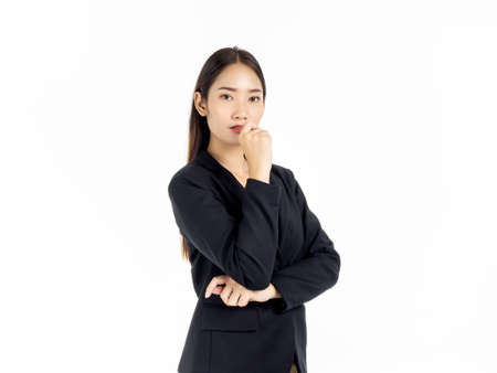 Portrait of serious young pretty Asian businesswoman in black suit looking camera isolated on white background. Stock Photo