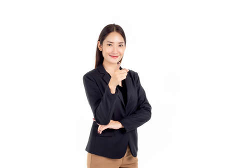 A confident pretty young Asian business woman in black suit with smiling, standing and pointing her finger at the camera isolated on white background.