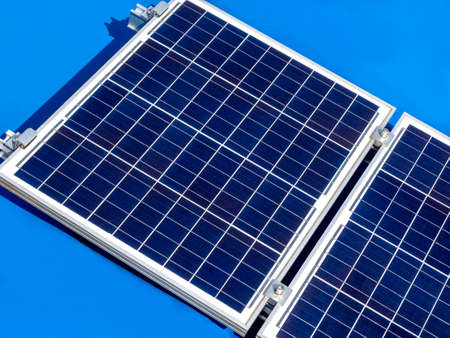Close up solar panel on blue boat roof background. Solar panel isolated on blue background.