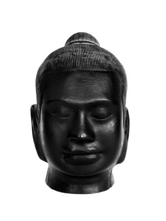 Head of Buddha, black color carved from stone isolated on white background, vertical style. The face of antique stone buddha, front view. Stockfoto