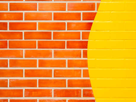 Brick wall background with yellow painted.Empty space on vivid color brick wall texture.