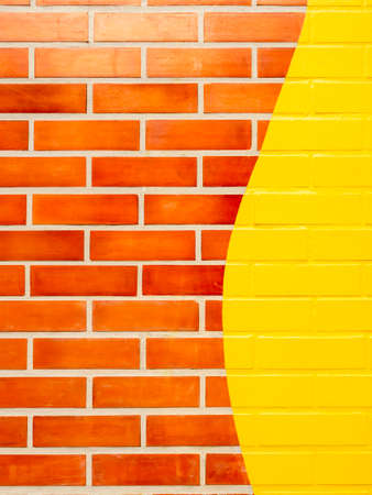 Brick wall background with yellow painted.Empty space on vivid color brick wall texture, vertical style. Stockfoto