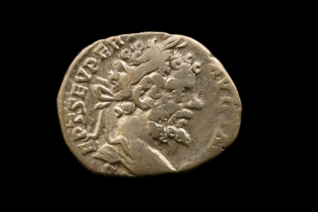 Antique Roman Coin Isolated On Black