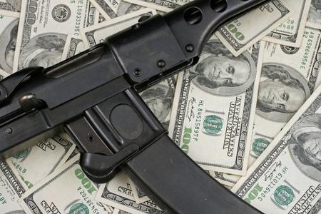 Gun On American Hundred Dollar Bills photo