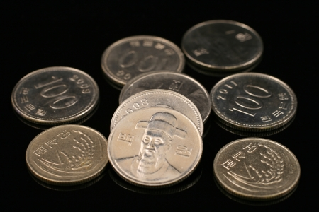 Korean Won Coins On Black Stock Photo