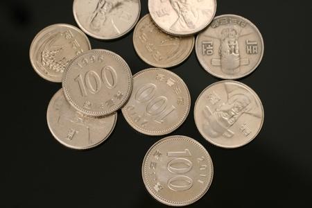 Korean Won Coins On Black Archivio Fotografico