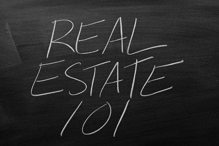 The words Real Estate 101 on a blackboard in chalk Stock Photo