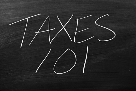 remedial: The words Taxes 101 on a blackboard in chalk