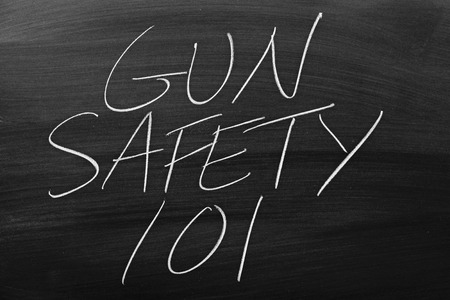 The words Gun Safety 101 on a blackboard in chalk