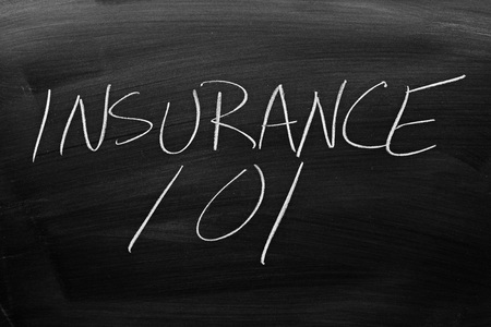 The words Insurance 101 on a blackboard in chalk