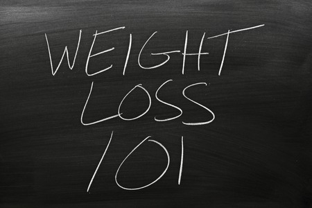 technical university: The words Weight Loss 101 on a blackboard in chalk