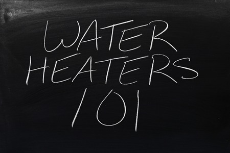 The words Water Heaters 101 on a blackboard in chalk Stock Photo