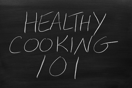 The words Healthy Cooking 101 on a blackboard in chalk Stock Photo
