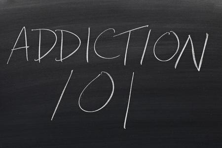 The words Addiction 101 on a blackboard in chalk Reklamní fotografie