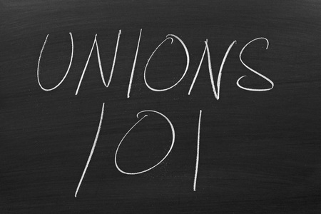 collective bargaining: The words Unions 101 on a blackboard in chalk