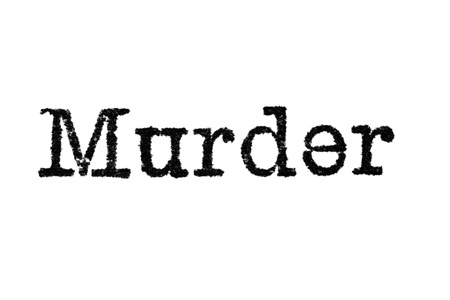 The word Murder from a typewriter on a white background Imagens