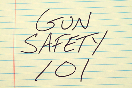 The words Gun Safety 101 on a yellow legal pad Stok Fotoğraf