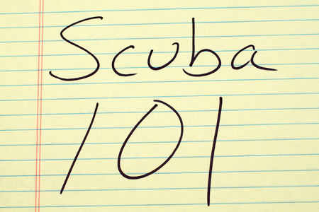 padi: The words Scuba 101 on a yellow legal pad